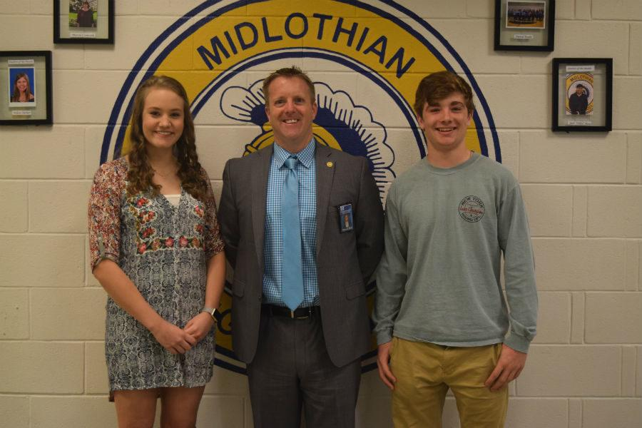 Principal Shawn Abel congratulates Midlo Students of the Year, Bailey Blair and Will Pomeroy.