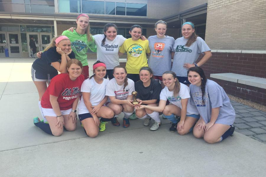 The+girls+soccer+team+won+first+place+in+its+division+during+the+indoor+season.