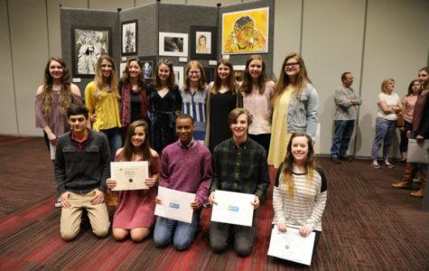 Scholastics winners show off their key awards.
