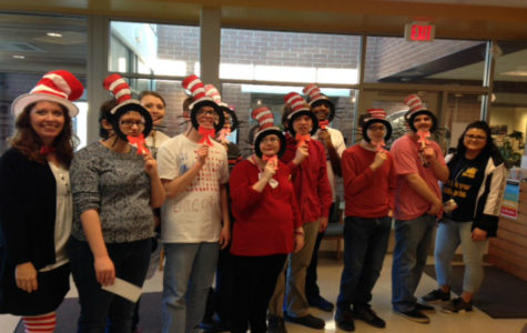 Midlothian High School students celebrate Read Across America Day with Cat in the Hat masks.