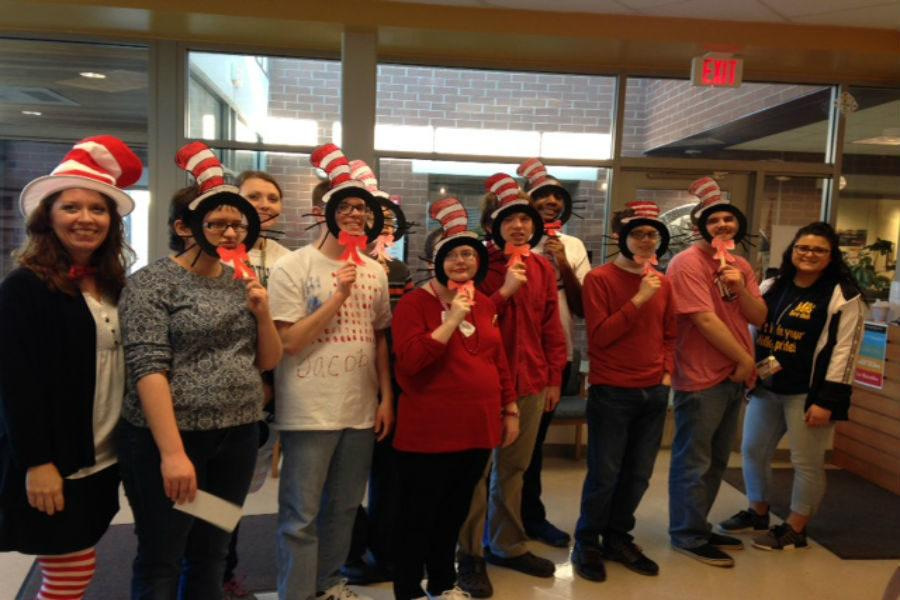 Midlothian+High+School+students+celebrate+Read+Across+America+Day+with+Cat+in+the+Hat+masks.+
