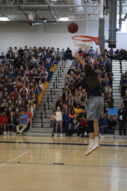 Senior Peyton Neff scores a basket during the first quarter.