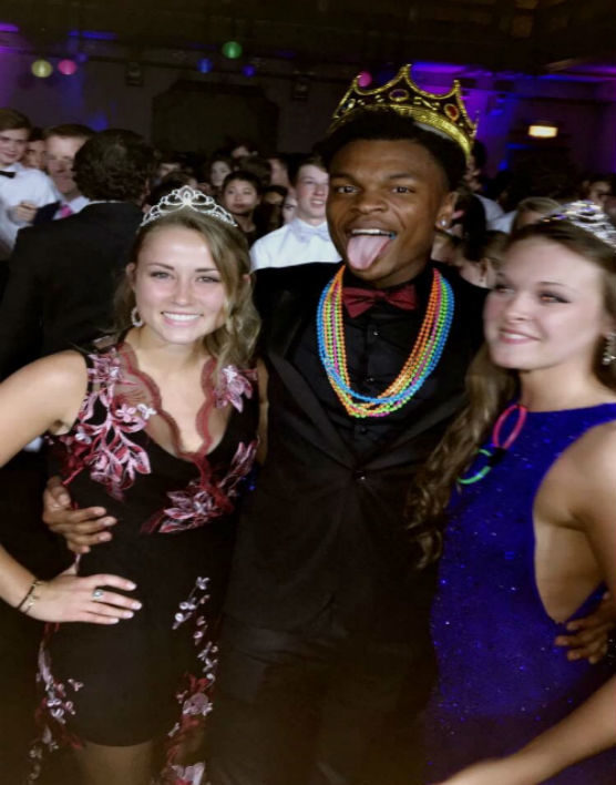 Prom+King+Rico+Coleman+celebrates+with+his+two+queens+Lara+Ann+Douglas+and+Lauryn+Basl.