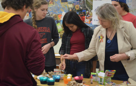 Frau Böer joins in the class to create an egg of her own.