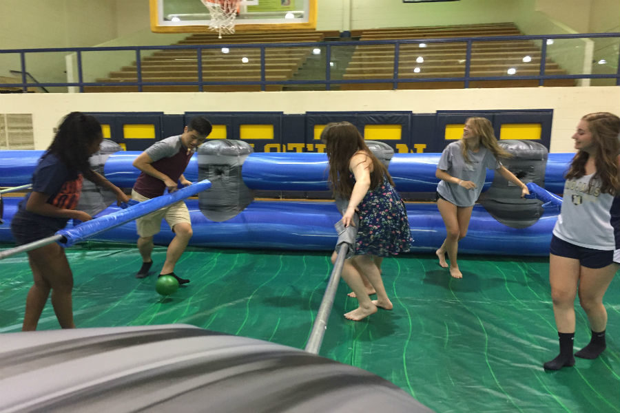 Students compete in human foosball during Post-Prom.