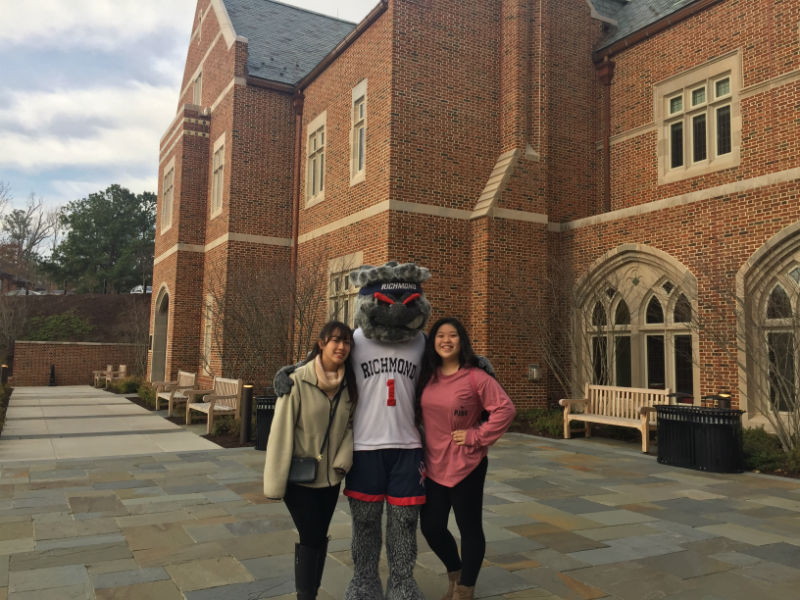 Sophomores+Amanda+Chok+and+Anna+Chen+meet+the+University+of+Richmond%27s+proud+Spider+mascot.+