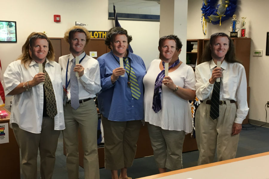 The office staff dress as Mr. Abel on Career Day during Teacher Appreciation Spirit Week.