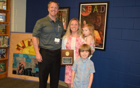 Midlo Principal Shawn Abel congratulates Midlo Teacher of the Year Mrs. Regina Warriner, joined by Jane and Benjamin.