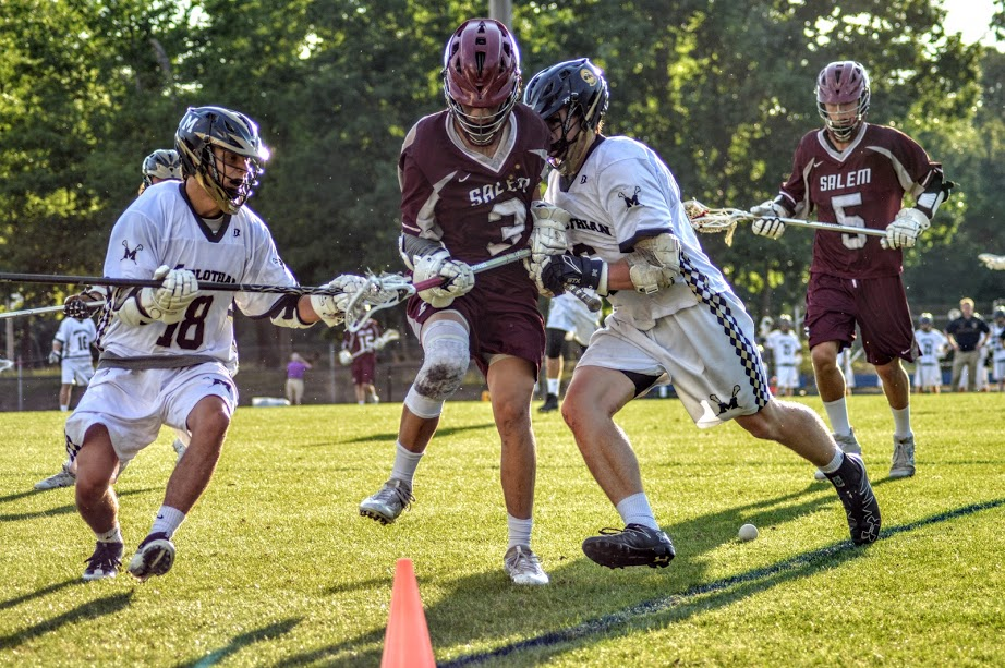 Mac Whitten and Coleman Rock fight a Salem defender for a ground ball.