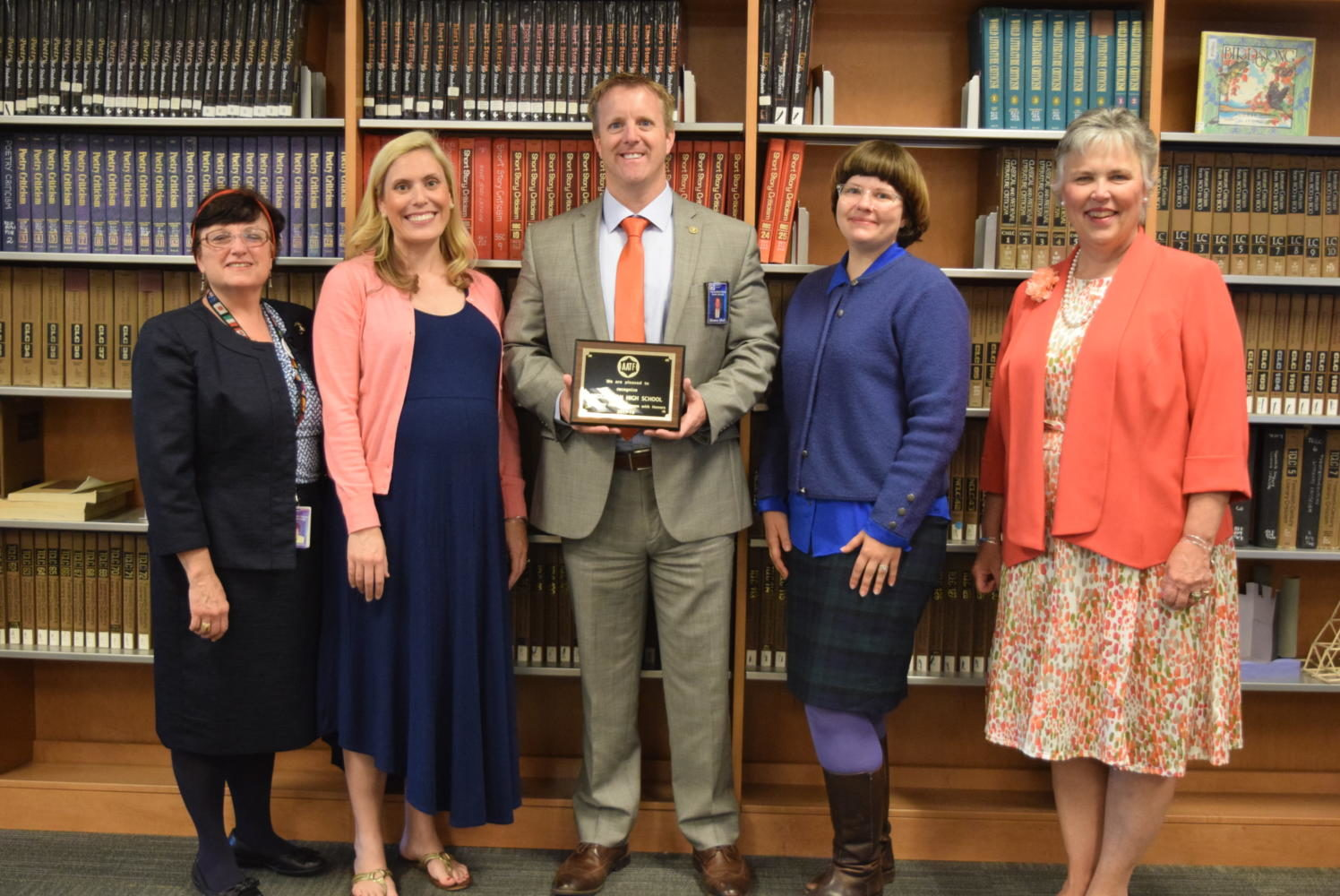 Dr. Linda Szwabowski , Mme. Lindsay Garrison, Midlo Principal Shawn Abel, Mme. Catherine Mazzola, and Mrs. Donna Dalton celebrate the Midlo French Department's distinction as an AATF Exemplary Program with Honors.