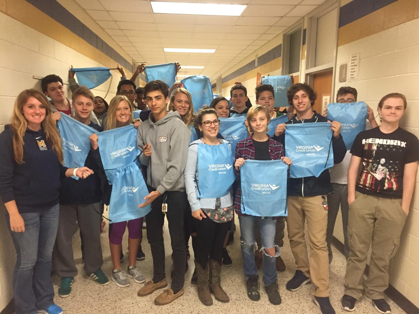 Ms. Kramer's class shows off their drawstring bags from Virginia Credit Union.