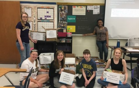 NEHS students gather in Mrs. Hill's room to sort books donated to Ettrick and Falling Creek Elementary Schools through the recent book drive.