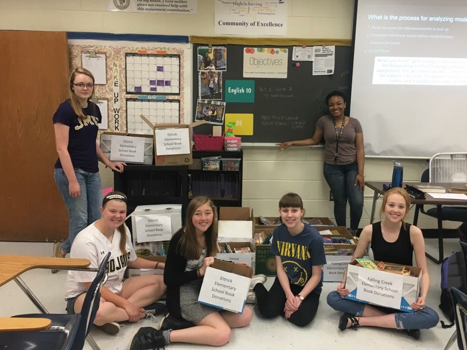NEHS+students+gather+in+Mrs.+Hill%27s+room+to+sort+books+donated+to+Ettrick+and+Falling+Creek+Elementary+Schools+through+the+recent+book+drive.