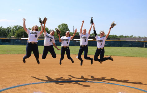 The softball seniors jump for joy as their high school careers wind down.