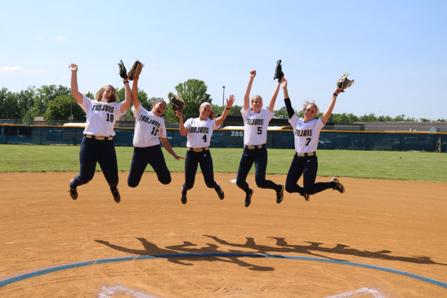 The+softball+seniors+jump+for+joy+as+their+high+school+careers+wind+down.
