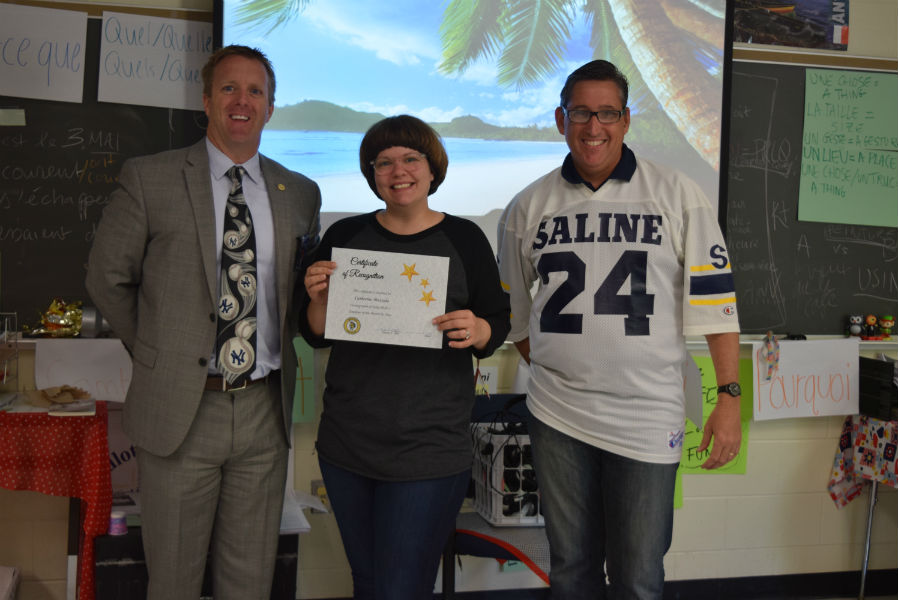 Mr. Abel and Mr. Gifford proudly congratulate May's Employee of the Month, Madame Mazzola
