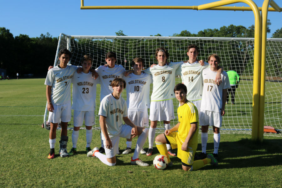 The+Midlo+boys+soccer+team+enjoys+senior+night+with+each+other.
