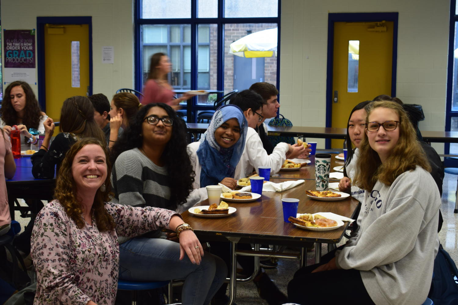 New students enjoy a good breakfast and the company of new friends.