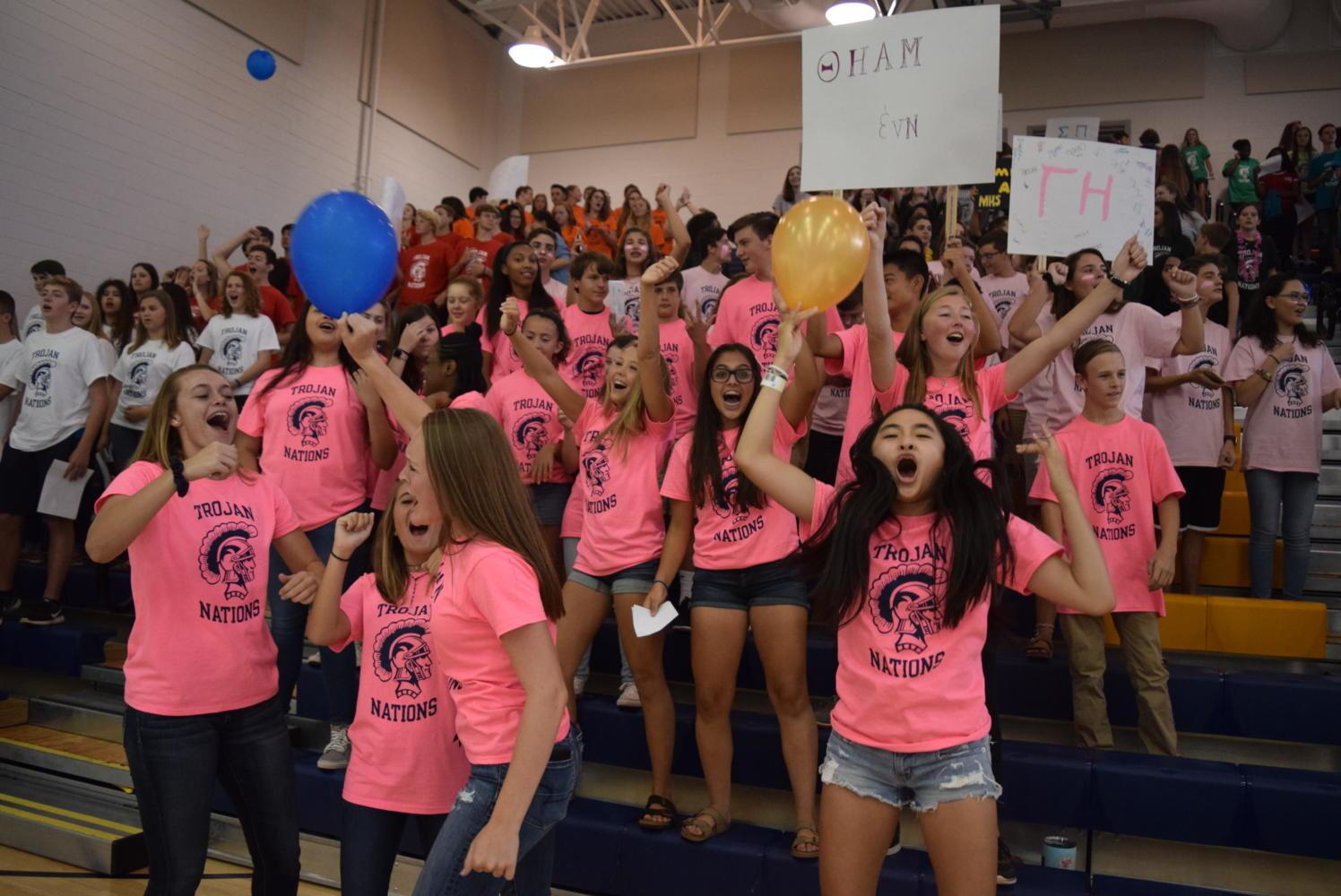 The pink Trojan Nation team shows their spirit.
