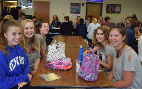 Anna Patterson, Hannah Bridges, Coleen Maloney, Morgan Sensabaugh, Jade Lamprecht take time to enjoy lunch and friend time.