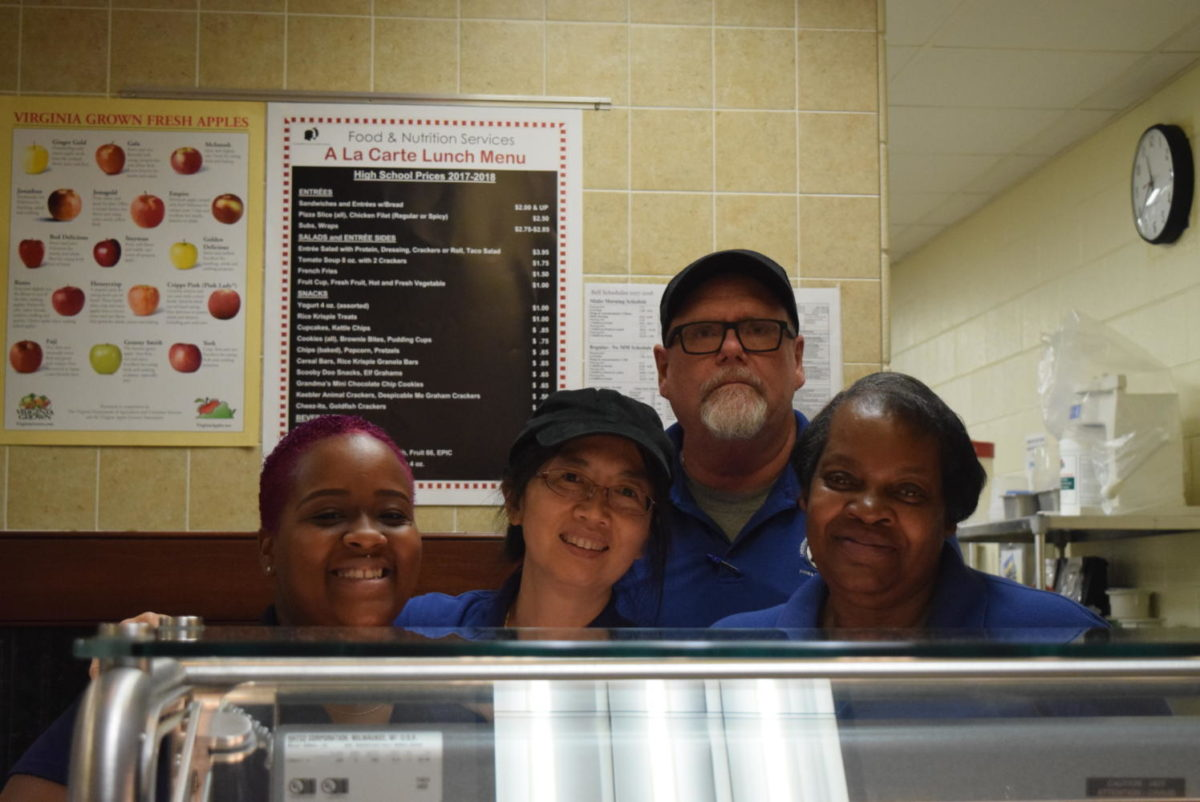 Ms.+Tabb%2C+Mr.+Ammons%2C+Ms.+Li%2C+and+Ms.+Scruggs+happily+serve+food+to+students.+
