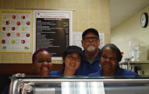 Ms. Tabb, Mr. Ammons, Ms. Li, and Ms. Scruggs happily serve food to students.