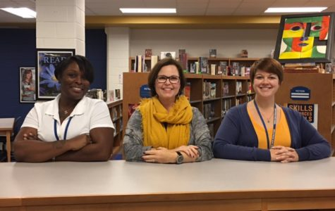 Come visit Midlo's library staff: (left to right): Ms. Dawson, Ms. Murfee, and Ms. Mazzanti.