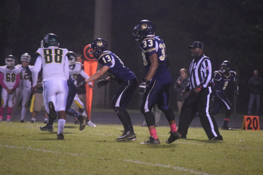 Brayden Staib and Omar Jackson watch the Clover Hill offense in an attempt to regain possession of the ball.