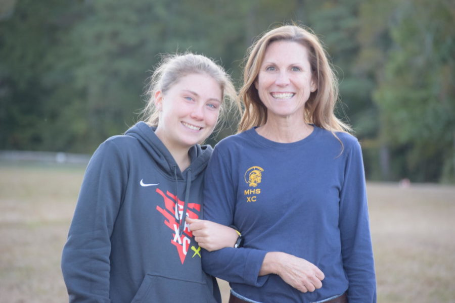 Camryn Adams, joined by her mother, celebrates at the Cross Country senior recognition.