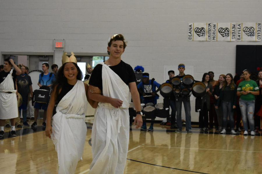 Senior princess (and Homecoming Queen) Joy Li is escorted by senior prince Devin McCombs during the homecoming pep rally.