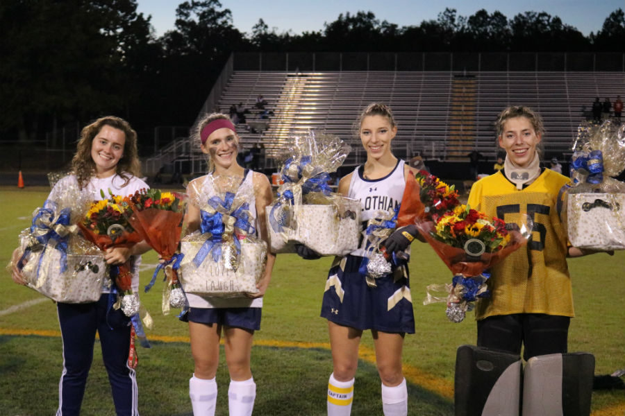 The senior field hockey players enjoy some of their last moments playing for Midlo.