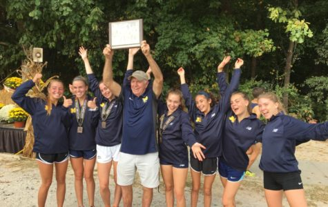 Coach Stan Morgan celebrates as Midlo girls placed first in the Great American XC race in Cary, NC, on October 7, 2017.