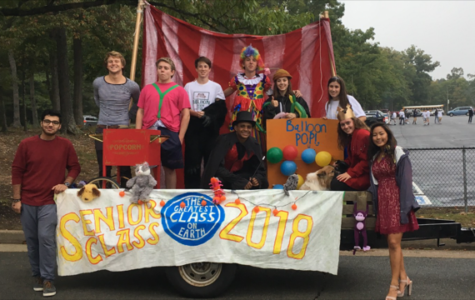 The senior class float provides a circus on wheels as it makes its way around the track.