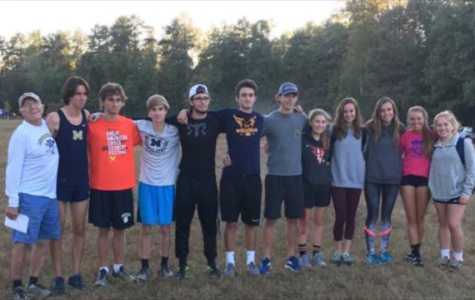 Cross Country seniors celebrate their season with Coach Stan Morgan.