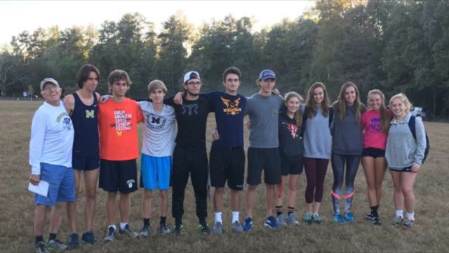 Cross+Country+seniors+celebrate+their+season+with+Coach+Stan+Morgan.