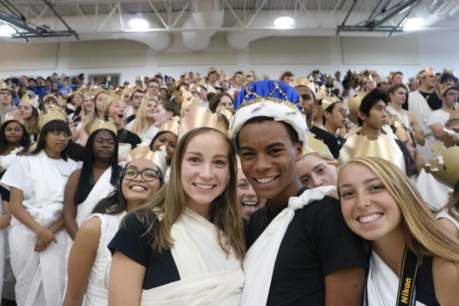 Katie Daniluk and Eva Johnson congratulate Homecoming King BJ Beckwith.