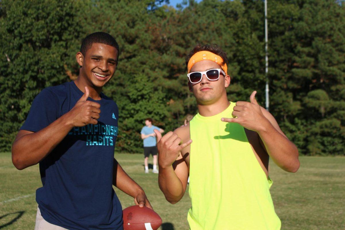 Justin Penn and Baylor Cumbea throw  a football around at the Senior Tailgate.