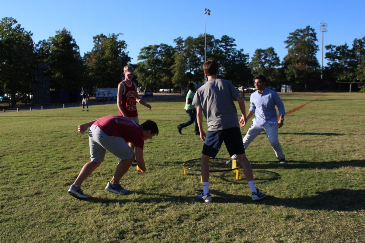 Kenny Harbula, Brad Lipsteuer, Finlay Raphael, and Faizan Saleem concentrate on battling each other in spikeball.