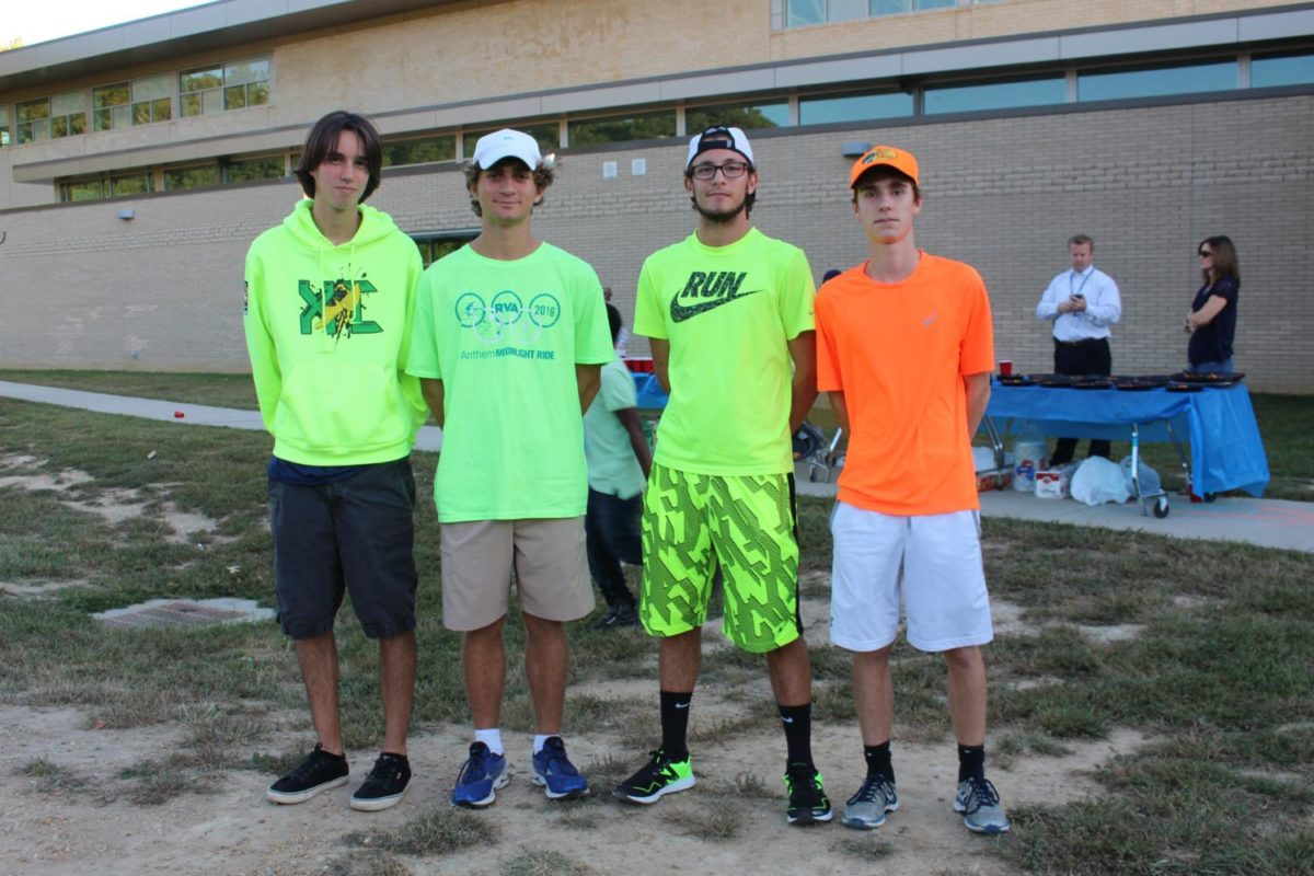 Kellan Nedwick, Robbie Rowley, Doug McCrate , and Clay Robb show off their neon clothes at the tailgate before the football game.