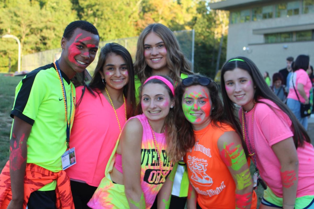 BJ Beckwith, Sarah Arezo, Erin Fogle, Kendall Bernard, Olivia Harriman, and Anna McElhinney paint up and enjoy the tailgate before the football game.