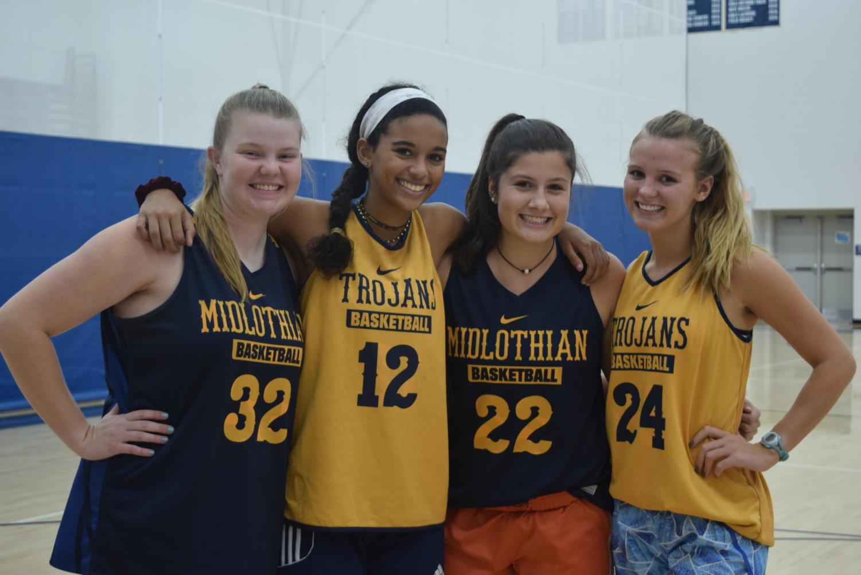 Morgan Gilbert, Alexis Kelley, Eleanor Ross, and Irish Kulas prepare to work hard at practice.