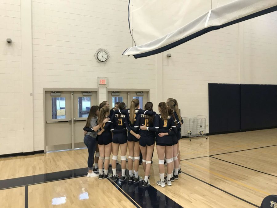 The+Lady+Trojans+Varsity+Volleyball+Team+huddles+before+their+match+against+Powhatan+High+School.
