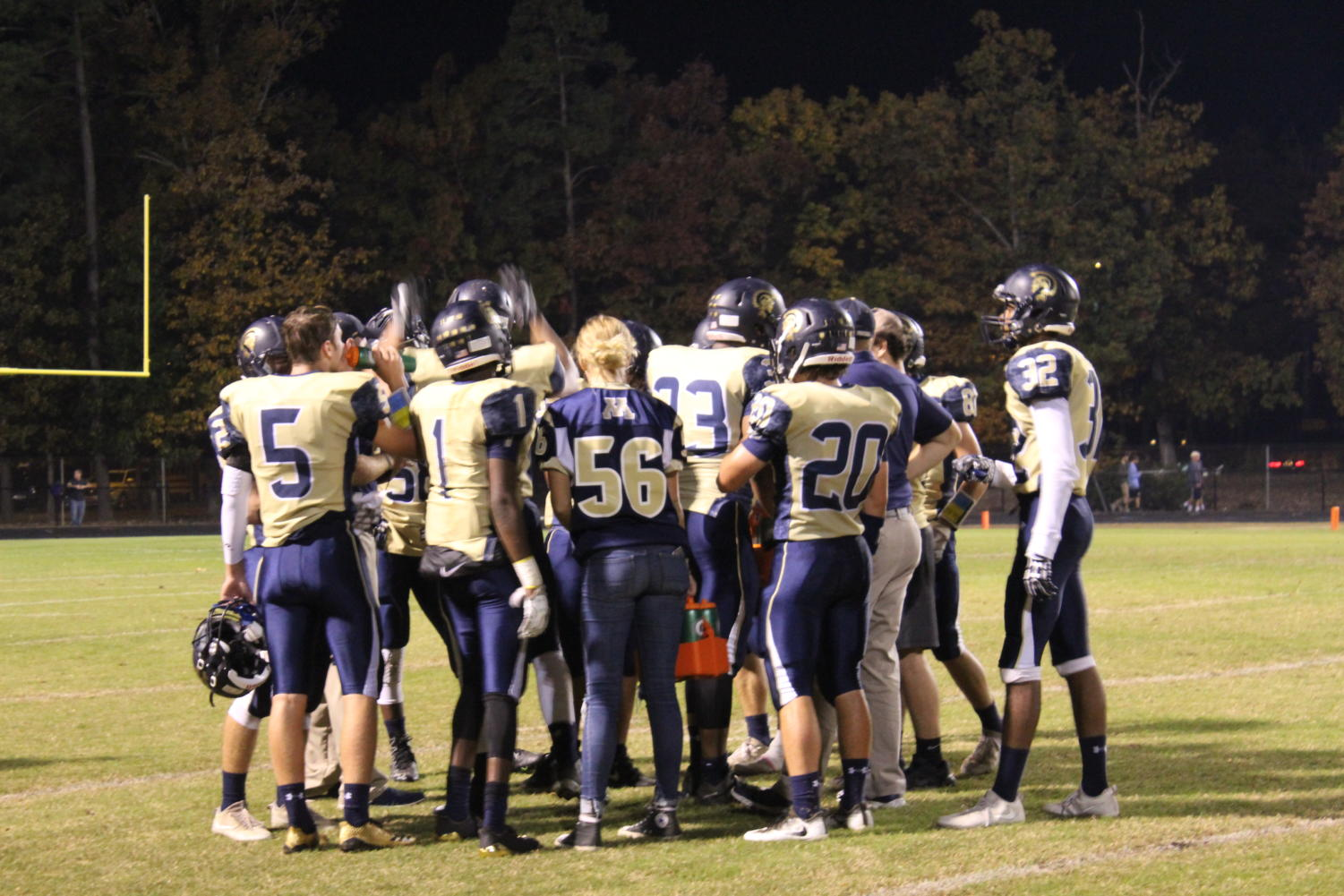 Midlo's starting offensive unit gathers in preparation for the big game ahead of them.