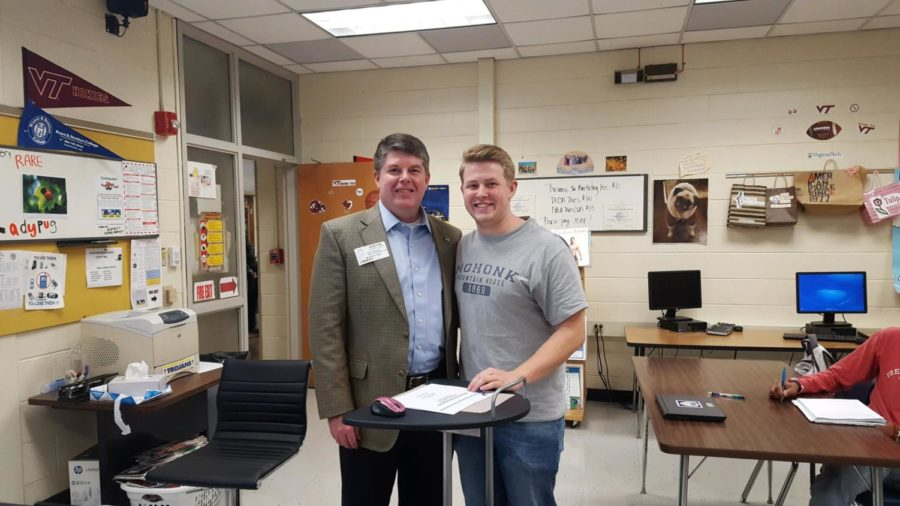 Jackson Spencer's father, Glenn Spencer, spoke  to IB Business classes about his experience as a human resources lawyer at Altria.