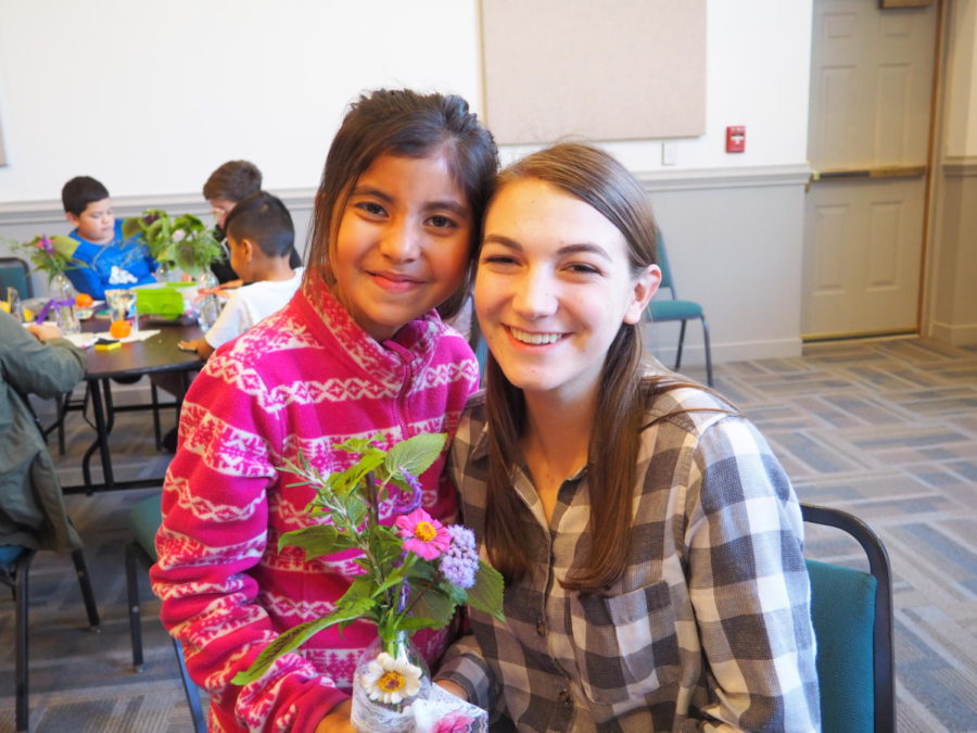 Devyn Vernier and her Homework Helpers student put on display their flower bouquet made from recycled materials.