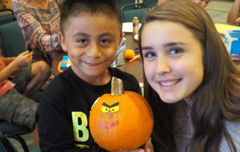 Hillary Hettinger and her Homework Helpers student show off their decorated pumpkin.