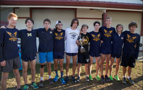 The Midlo Boys Varsity XC team celebrates their victory.