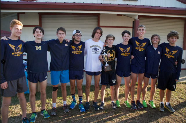 The+Midlo+Boys+Varsity+XC+team+celebrates+their+victory.+