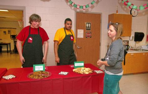 Mrs. Randrianasolo helps her students organize their sweet treats.