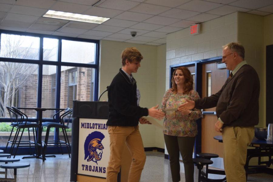 Mr. Cheatham, Mrs. Hoke, and Mr. Wilson welcome new inductee, James Davis.